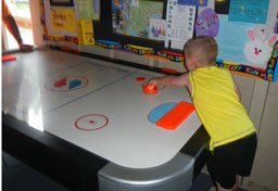 Challenge someone to an Air Hockey game